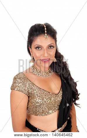 A lovely young woman in a short gold color top and long curly black hair standing halve length isolated for white background.