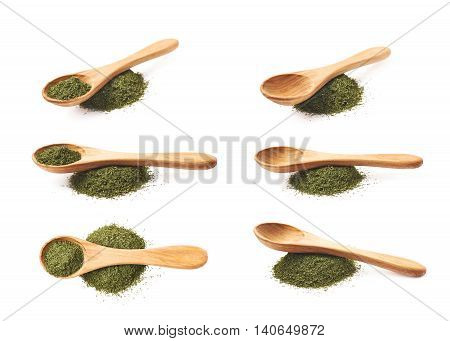 Wooden spoon over the pile of dried dill seasoning, composition isolated over the white background, set of six different foreshortenings