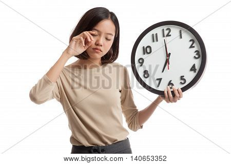 Sleepy Young Asian Business Woman With A Clock In The Morning
