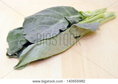 Chinese Kale Or Chinese Broccoli Vegetable Isolated On Wood