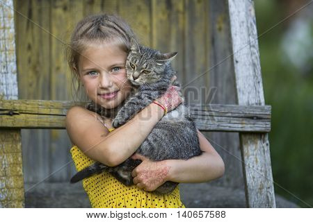 Little girl playing with a cat.
