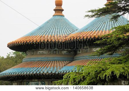 A Chinese designed roof on a gazebo in Tiantan park or temple of heaven scenic area in Beijing China.