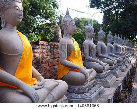 line of buddha statue in chaimongkol temple, ayutthaya, Thailand