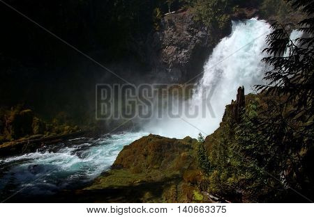 The Mckenzie River goes over Sahallie Falls in massive quantities of spring run off.