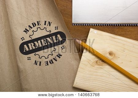 Industrial poster Made in Armenia the stamp imprint on paper.
