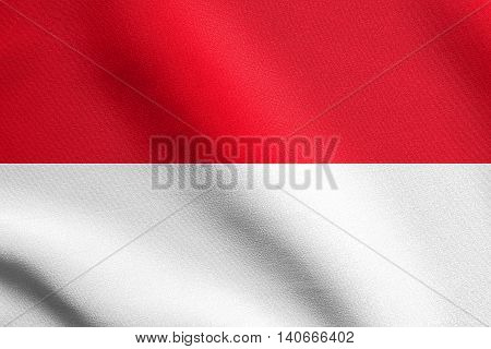 Flag of Indonesia, Monaco, Hesse waving in the wind with detailed fabric texture. Indonesian national flag.