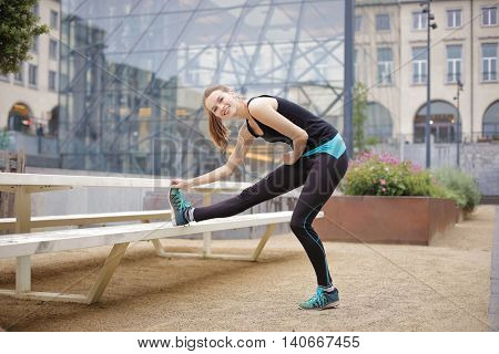 Trained woman in sporty clothes