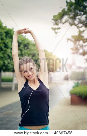 Smiling woman training outdoors