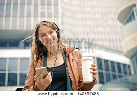 Happy woman wearing headphones