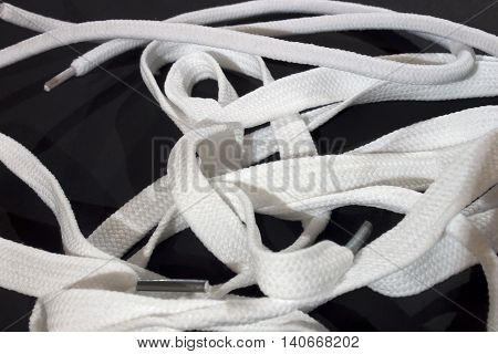 This is a photograph of White Shoelaces