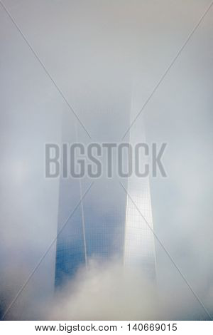 NEW YORK CITY - NOV 12: One World Trade Center in fog on November 12, 2014 in Manhattan, New York City. With population of 8.4M, it is the most populous city in the United States.