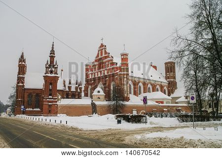 St. Anne's Church and the church of the Bernardine Monastery under snow in Vilnius Lithuania.