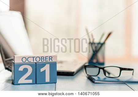 October 21st. Day 21 of month, calendar on teacher table background. Autumn time. Empty space for text.