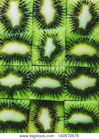 Green slices cube kiwi, fruits texture background