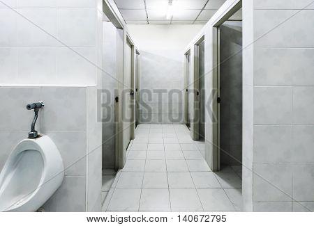 Old dirty restroom, public deserted gents restroom