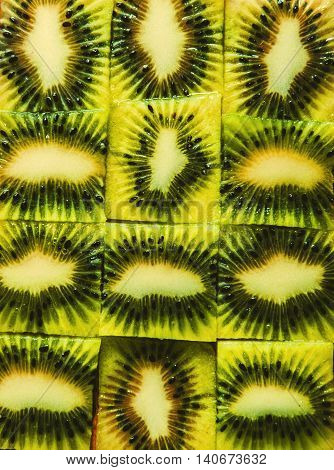 Yellow slices cube kiwi, square shape background