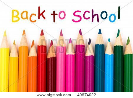 Colorful pencil crayons on a white background Back to school