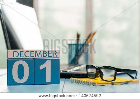 December 1st. Day 1 of month, calendar on teacher workplace background. Winter time. Empty space for text.