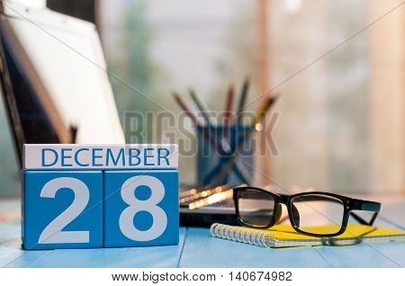 December 28th. Day 28 of month, calendar on blogger workplace background. New year at work concept. Empty space for text.