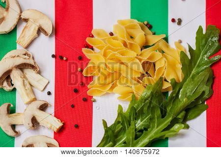 Food in colors of Italian flag. Cuisine is characterized simplicity, with dishes having only four to eight ingredients. Italian cooks rely on quality of ingredients rather than elaborate preparation.