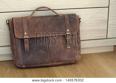 brown bag on wooden background.