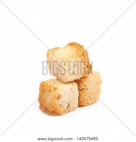 Pile of garlic white bread croutons isolated over the white background