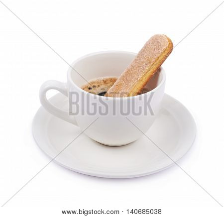 White ceramic cup of coffee on a plate and ladyfinger savoiardi cookie in it, composition isolated over the white background