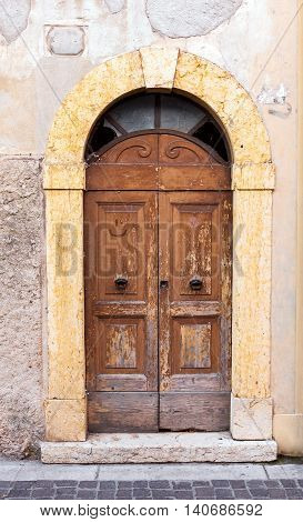 Traditional old weathered wooden doors in Italy