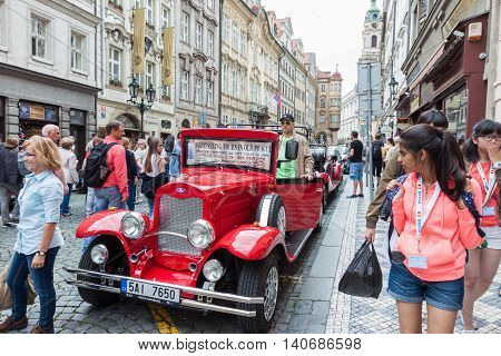 PRAGUE CZECH REPUBLIC - JUNE 27 2016: Vintage sightseeing tour car waiting for tourists in old town of Prague Czech Republic