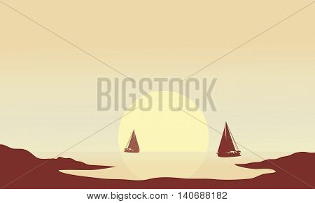 Silhouette of ship at afternoon in the beach