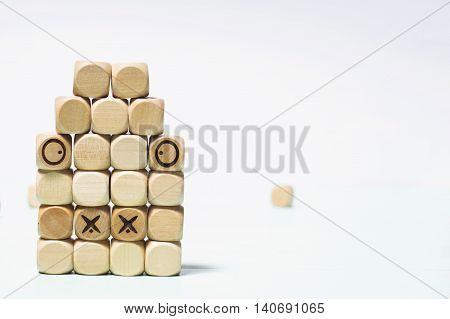 Background cubes. Small wooden cubes. Tic Tac toe.