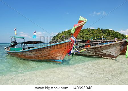 Boat Thai in The beautiful miracle beach & crystal clear water at Koh Kai Koh Tub & Koh Mor Krabi Thaiand.