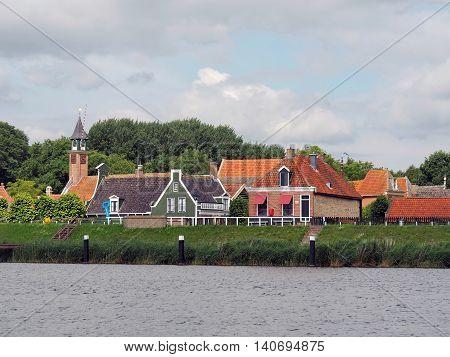 Small fishing Village behind a green Sea Dyke