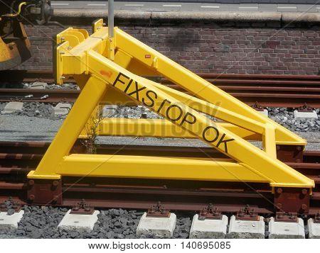 Yellow steel railway buffer in Maastricht station Holland