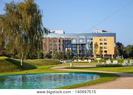 SOPOT, POLAND -  JULY 25, 2016: People relaxing and strolling in park at summer time. Park is located on the boundary between two cities - Sopot and Gdansk.