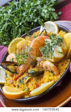 tradirional spanish cuisine paella with shrimps seafood and vegetables