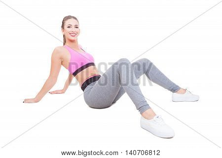 Woman Wearing Sports Wear Laying Down Tired After Workout