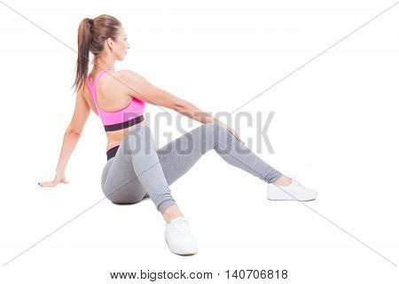 Fit Girl Sitting Down Twisting Waist As Training