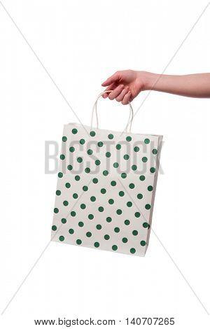 Hand holding giftbag isolated on white
