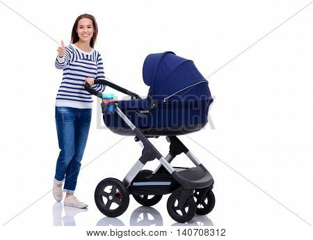 Full length portrait of a mother with a stroller showing ok, isolated on white background