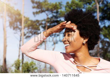 Beautiful Woman Standing Outdoors Looking Away