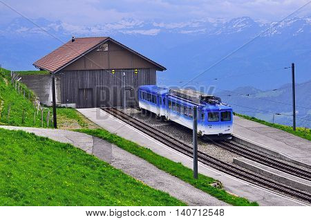 Rigi mountain Switzerland - June 10 2010: Blue Passenger train stands by the depot.