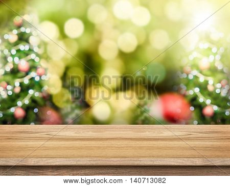 Brown Wood Table Top With Abstract Blur Christmas Tree Background With Bokeh Light,holiday Backdrop,
