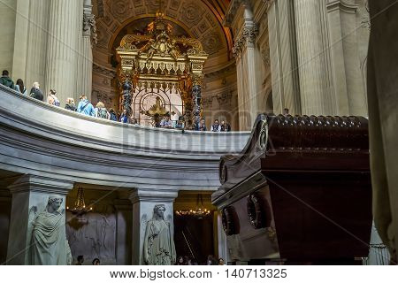 PARIS, FRANCE - MAY 12, 2015: Tomb of Napoleon Bonaparte is under the gilded dome of cathedral od St. Louis Invalides.