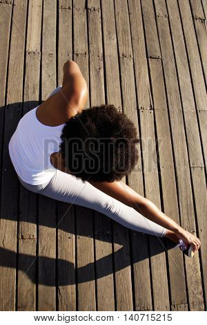 Young Woman Doing Stretching Exercise At Beach