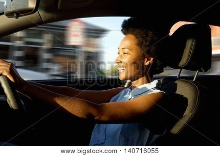 Happy Young African Woman Driving A Car