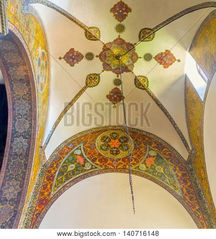 VAGHARSHAPAT ARMENIA - MAY 30 2016: The semi-dome of Etchmiadzin Cathedral decorated with colorful frescos with floral themes on May 30 in Vagharshapat.