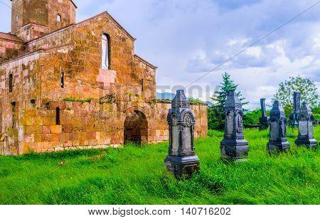 The black carved tombstones next to Odzun Basilica Alaverdi Armenia.