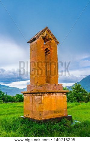 The Soviet era monument with the carved star and relief of the Hammer and Sickle located next to the Basilica of Odzun village Alaverdi Armenia.