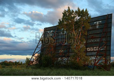 Back view of a old screen in an abandoned drive-in